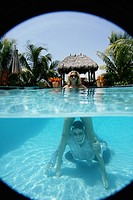 Couple in a pool, man in water (thumbnail)