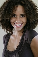 Young African-American woman smiling, looking at camera