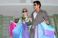 Fashionable couple shopping