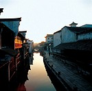 traditional Chinese folk houses along the river in Wu Town,Zhejiang Province,dawn