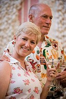 Portrait of a cheerful senior woman and man holding wineglass