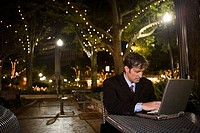 Businessman using laptop computer at night