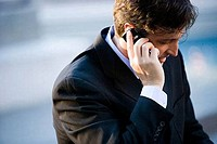 Close_up of a businessman using cellphone