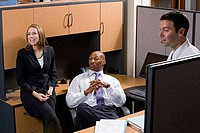 Businesswoman smiling by colleagues in an office