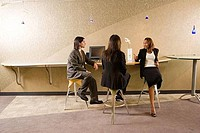 Businessman and businesswomen discussing in the office