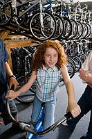 Portrait of a smiling girl in a bicycle shop