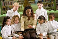 Teacher teaching students in the library