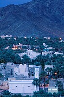 OMAN-Western Hajar Mountains-Bahla: Bahla Town and Village Mosque / Dusk