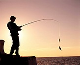 Silhouette of a child fishing