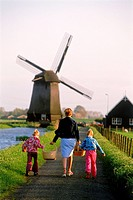 Rear view of mother and children walking on pathway in Holland