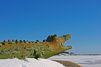 Side view of a crocodile sculpture in snow
