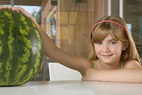 Young girl with watermelon