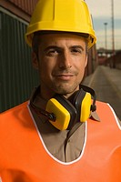 Portrait of a dock worker wearing a hardhat