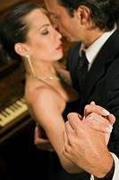 Close_up of a young couple dancing at a party