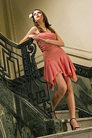 Young woman standing on a staircase