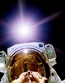 Astronaut self_portrait. Composite image of an astronaut taking a picture of himself whilst performing a space walk, or extra_vehicular activity EVA, ...
