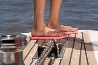 Detail of girl's feet wearing flip flops