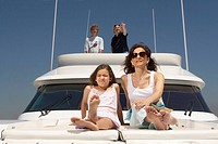 Young family relaxing on boat