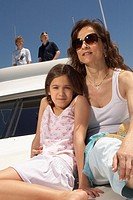 Young family relaxing on boat (thumbnail)