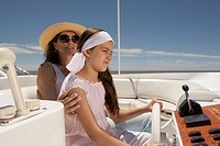 Mother and daughter driving boat