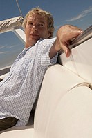 Mature adult man relaxing on boat (thumbnail)