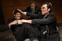 Businessmen pulling hair and fighting over money (thumbnail)