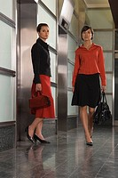 Businesswomen standing in hallway