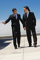 Businessmen talking on roof
