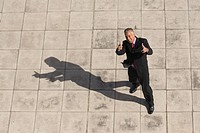 High angle view of happy mature businessman