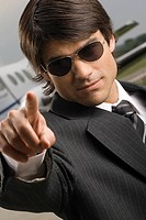 Close_up of a businessman pointing