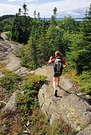 Woman hiking Hattie Cove Trail, Pukaswa National Park, Ontario, Canada.