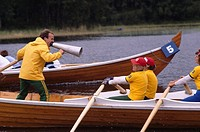 Person with a megaphone on a rowboat