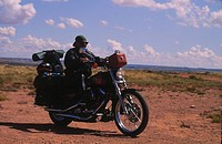 Man driving motorcycle at seashore