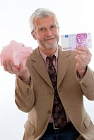 older man with piggy bank and money