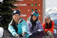 Young asian female skiers and snowboarders, Whistler Mountain, British Columbia, Canada.