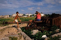 Children play on an abandoned Cuban tank that has been rusted away by the sea air over the years. The tank faces the Florida Straits and was placed on...
