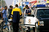 Police and teens on bicycles in Venice, California.