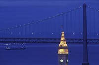 San Francisco, California, USA, Oakland Bay Bridge with Clock tower in forground at dusk