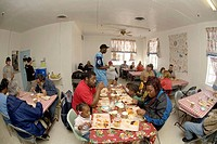 Volunteers serve Christmas dinner during homeless shelter activities for low income and homeless people in Barstow, CA.