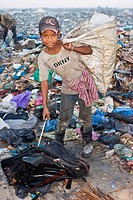 A garbage picker on a garbage heap in Stung Meanchey, the garbage dump in Phnom Phen, Cambodia.