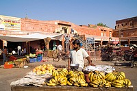 A man sells fruit at a stand in downtown Jaipur, Rajasthan, India.