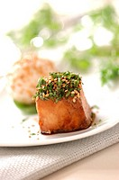 Cube of caramelized grouper fish with soya and honey, topped with herbs and sesame seeds (thumbnail)