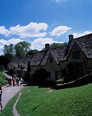 Bibury Row of houses Cotswolds United Kingdom Blue sky Clouds Roof People Lawn Tree
