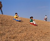 Grass slide Sky Hill Grass Sleigh Child Parent and Child People