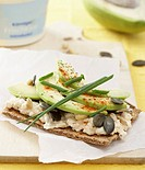 Crispbread topped with cottage cheese, avocado & pumpkin seeds