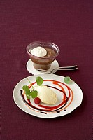 White chocolate mousse with fruit sauces, chocolate cream