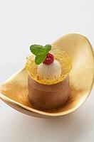 Small Dobos cake with praline ice cream & caramel strands