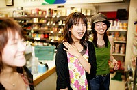 Three Young Adult Women shopping