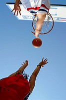 Basketball player shooting a goal an action shoot