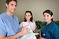 Portrait of three young adult nurses